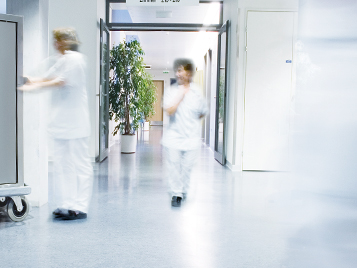 Healthcare sector: two employees in a hospital on blue Forbo linoleum.