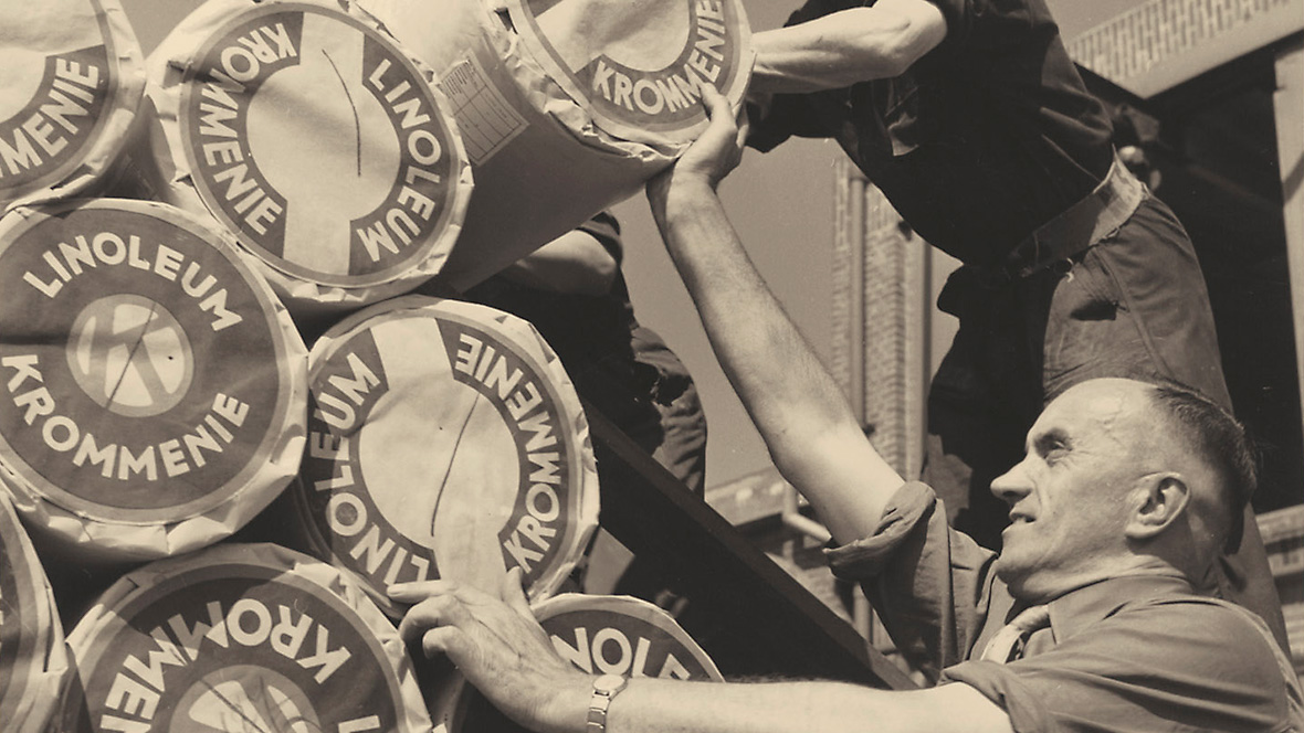 Archive photograph of Forbo employees stacking linoleum rolls.
