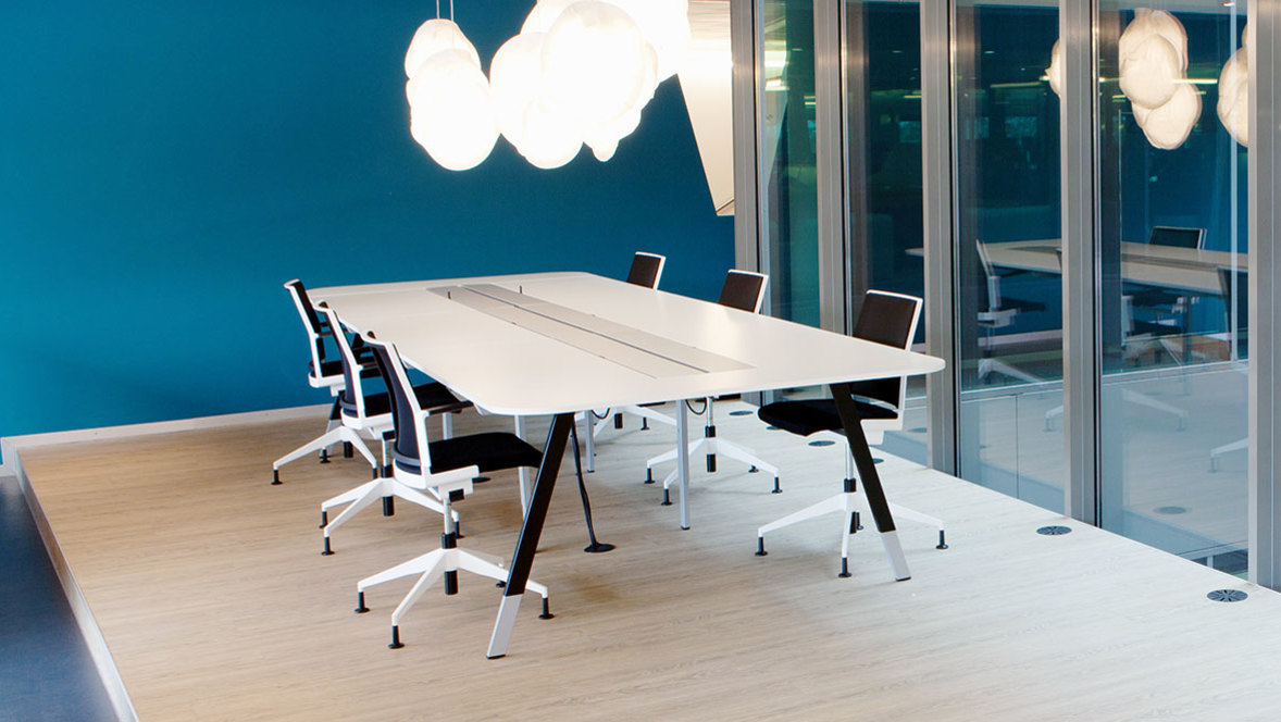 Offices and public buildings: meeting room with chairs and table on bright Forbo Floor.