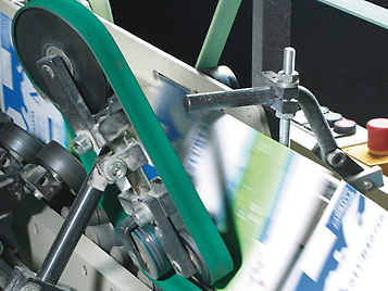 Paper  and printing: Forbo Siegling Extremultus  flat belts in use in a packing machine.
