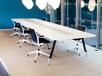 Offices and public buildings: meeting room with chairs and table on bright Forbo LVT (Allura Luxury Vinyl Tiles).
