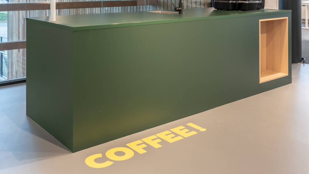 Green Marmoleum with yellow COFFEE letters HVEG Fashion Group