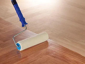 Primers for parquet laquers