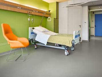 Hospital bed on grey Sarlon floor