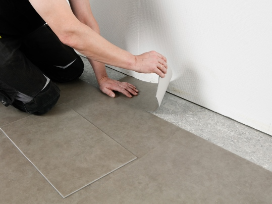Installing Allura Flex tackified modular tiles